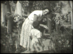 1261 Mother and son in the garden Stock Footage