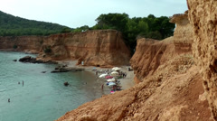 Europe Spain Balearic Ibiza coves and landscapes 054 red steep rock bay Stock Footage