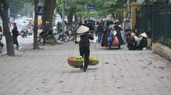 VIETNAMESE WOMAN BALANCING FRUIT Stock Footage