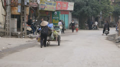 VIETNAMESE WOMAN PUSHING CART - stock footage