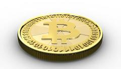 Golden Bitcoin falling and bouncing on a surface - stock footage