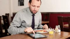 Businessman with tablet computer eating tasty english breakfast HD Stock Footage