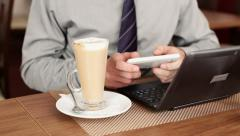 Businessman hands texting on smartphone in cafe HD Stock Footage