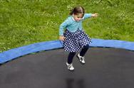 Stock Photo of girl jumps on trampoline