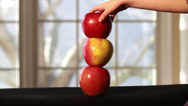 Stock Video Footage of 0639 Apples On Top of Each Other with Tree in Background