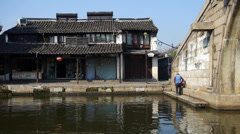 Chinese ancient hourse & bridge,old woman faltering,water town resident life. Stock Footage