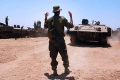 Idf forces tanks and armed vehicles outside gaza strip Stock Photos