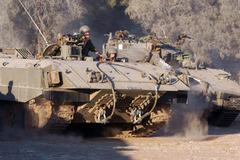 israeli soldiers and armored vehicle - stock photo