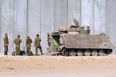 Israeli soldiers and armored vehicle Stock Photos