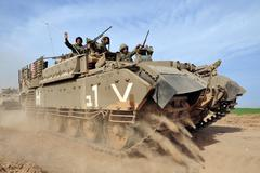 Israeli soldiers on armed vehicle Stock Photos