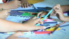Asian children sharing pencils at school Stock Footage