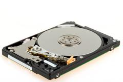 uncovered 2,5 inch notebook hard drive - stock photo
