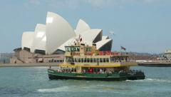 Pan of ferry passing opera house, sydney, australia Stock Footage