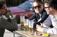 Stock Photo of young men drinking beer