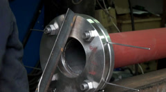 Flange bolts metal pipe plumbing - stock footage