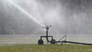 Stock Video Footage of sprinkler head watering the grass in sport field.