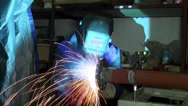 Stock Video Footage of Gas welding metal fire pipe plant Sparks
