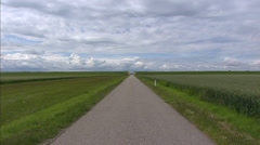 Landscape of Carel Coenraadpolder with narrow road and dike coupure at horizon Stock Footage