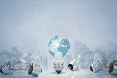 Light  bulb with world map and city Stock Illustration