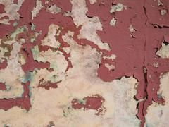 Cracked paint on the concrete wall Stock Photos