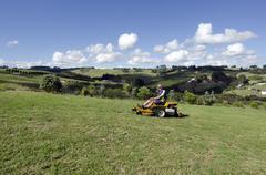 man ride on lawn mower - stock photo
