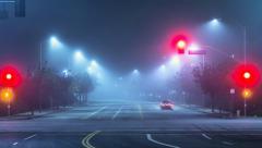 Foggy night city street Stock Footage