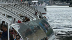 Tourists embarking cruise boat for river tour on River Seine, Paris, France. - stock footage