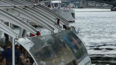 Tourists getting ready for a boat crusing tour on River Seine, Paris, France - stock footage