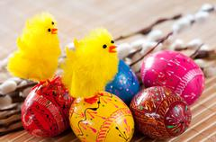 Easter eggss and yellow fluffy chickens Stock Photos