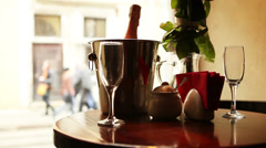 Cute dating scene. Champagne in bucket with glasses. - stock footage