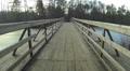 Wooden Bridge  over frozen  winter river. Aerial Footage