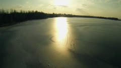 Sunset  on  frozen lake. Aerial Stock Footage