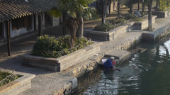 Human wash cloths in river,Traditional Chinese houses,XiTang Water Town,china. Stock Footage