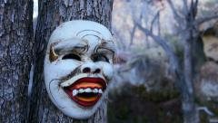Ritual Mask From Bali in Scary Landscape Close Up with Tilt Up Stock Footage