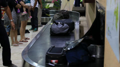 Passengers at baggage reclaim in airport Cebu, Philippines. Stock Footage