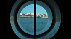 Port hole cruise ship ocean urban view HD 1783 Stock Footage