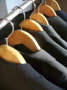 Row of men's suit jackets - stock photo