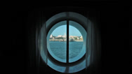 Stock Video Footage of Cruise ship port hole window looking out window HD 1781