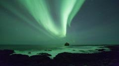 Aurora (northern lights) over the rocky Icelandic coastline 4k Stock Footage