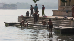 Indian people bathing in Pichola Lake - Udaipur India Stock Footage
