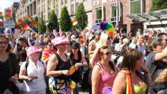 Rainbow flag waving at Gay Pride Parade. - stock footage