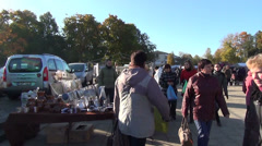 Autumn fair square. Vendors stand stalls people looking around Stock Footage