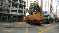Taxi, tankers, cars, cyclists and tram in Hong Kong Stock Footage