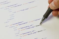 pointing on html code - stock photo