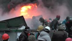 Stock Video Footage of Protesters protect the barricades in Kiev.