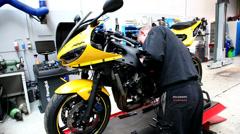 Motorcycle repair Stock Footage