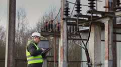 Electrician near to high-voltage cable episode 2 Stock Footage