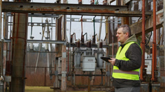 Electrician in electrical substation episode 2 - stock footage