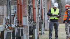 Electricians near high voltage power divider episode 1 Stock Footage