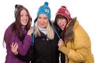 Stock Photo of group of happy women in winter with gloves, scarf and caps